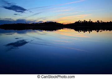 Evening peace on the lake Pongoma. Karelia, Russia -...