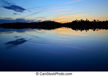 Evening peace on the lake Pongoma. Karelia, Russia -...