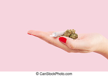 Woman holding cannabis bud. - Cannabis bud and marijuana...
