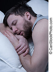 Man in deep sleep - Close-up of young man in deep sleep