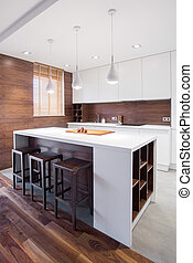 Modern kitchen island - White and modern kitchen island in...