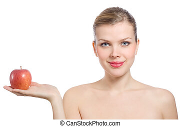 beautiful young blonde woman holding a red apple