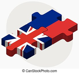 United Kingdom and Haiti Flags in puzzle isolated on white...