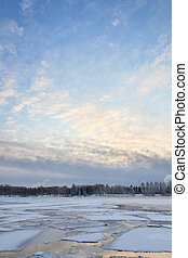 Thin ice on a lake at sunrise - Thin ice and chunks of ice...