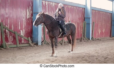Young woman ride a horse at the stable - Young people and...