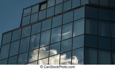 Clouds refelected in modern office building