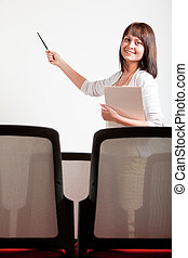 woman presenting - woman making a presentation in class,...