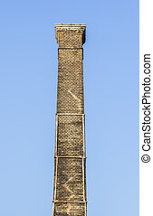 Old brick chimney - Very old brick chimney with clear sky