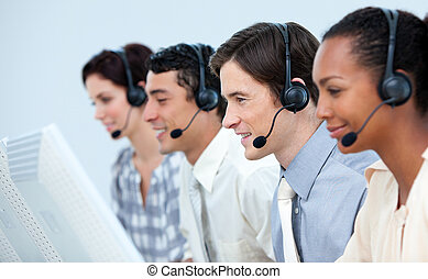 Concentrated business people using headset