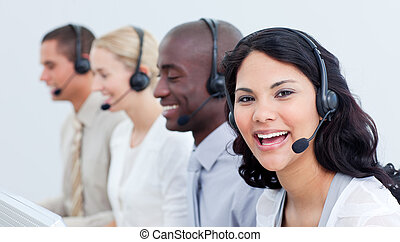 A diverse business team talking on headset