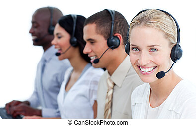 Cheerful business team with headset on in a call center