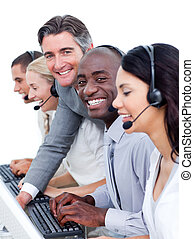 Competive manager checking his team\'s work in a call center