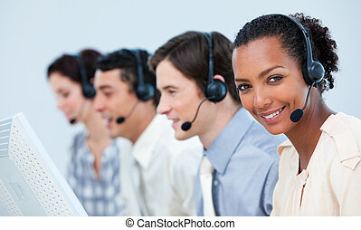 Multi-ethnic business people using headset in a call center