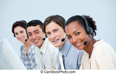 Ambitious business people using headset in a call center