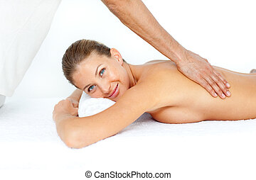 Cheerful woman getting a spa treatment