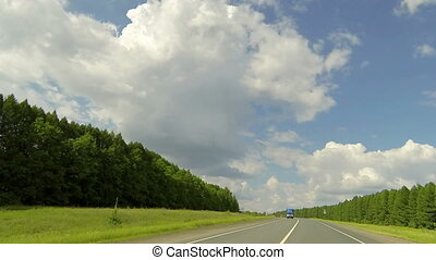 Clouds over the road The path from Toburdanovo village -...