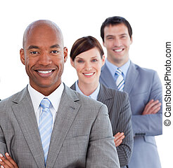Portrait of positive business team against a white...