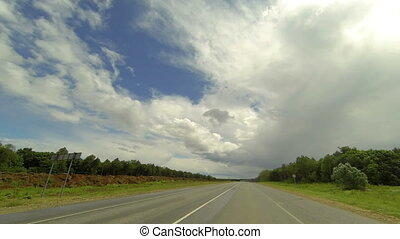 Clouds over the road The path from Ekaterinovka village -...