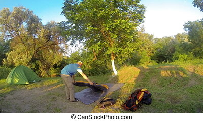 Assembling a tent on the nature. Seversky Donets River,...