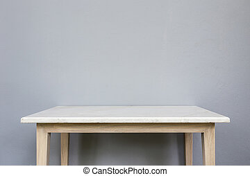 Empty top of white mable stone table on grey wall...