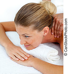 Young woman receiving a massage