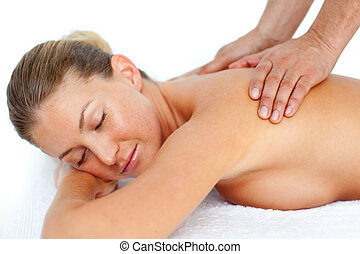 Relaxed woman receiving a massage in a spa center