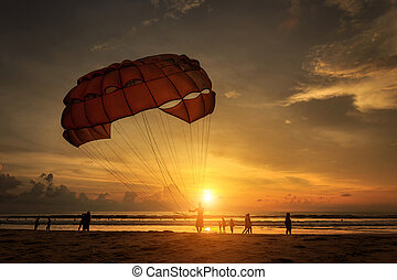 Man is preparing para sailing at the beach in Thailand -...