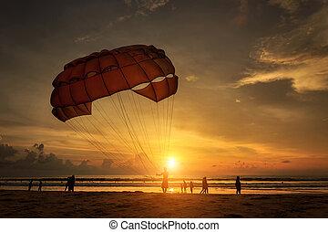 Man is preparing para sailing at the beach in Thailand -...