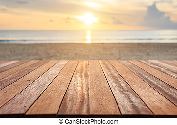 Top of wooden table at sunset beach. Can use for product...