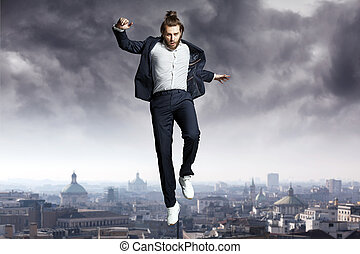 Fashion man jumping to the sky