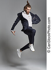 Young energetic man wearing suit - Young energetic man...