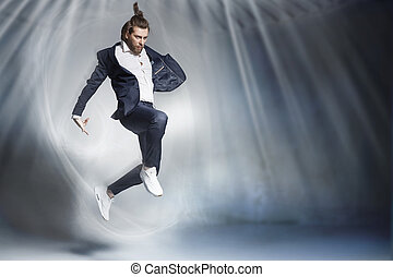 Handsome jumping businessman wearing elegant stuff -...