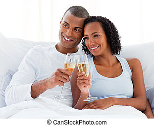 Loving couple toasting with Champagne