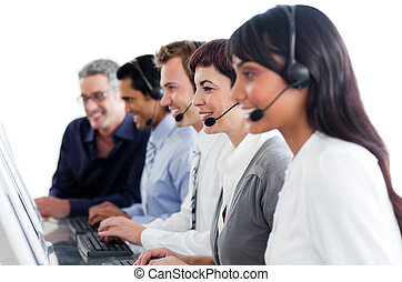 Portrait of business people working in a call center against...