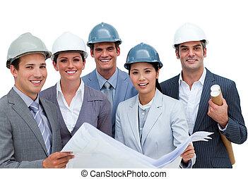 International architects studying blueprints
