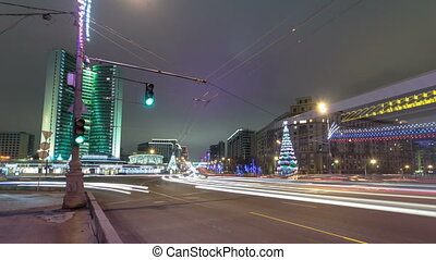 Buildings at New Arbat Street winter night timelapse. New Arbat is located in the central part of Moscow