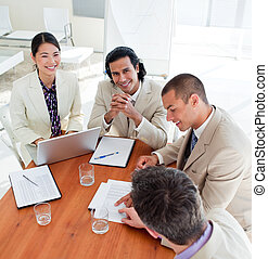 Concentrated business associates closing a deal in a meeting...