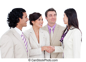 International business co-workers shaking hands