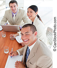 Confident business people in a meeting