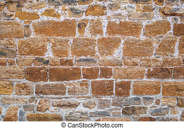 Old brown wall with bluish nuances - Old brown stone wall of...