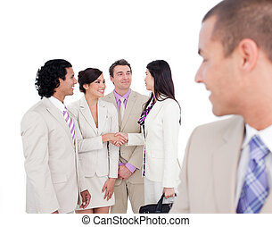 Positive business co-workers shaking hands against a white...