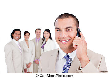 Charming businessman talking on phone against a white...
