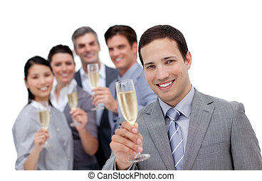 Cheerful business team toasting with Champagne against a...