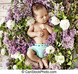 Cute child sleeping on the chaplet - Cute baby sleeping on...