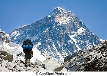 view of Everest from Gokyo valley with tourist on the way to...
