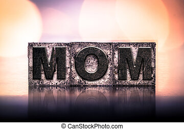 Mom Concept Vintage Letterpress Type - The word MOM written...