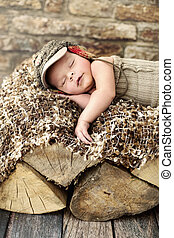 Little child sleepieng on the piece of wood - Little cute...