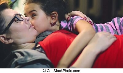 daughter kissing a girl hugging a woman are happy mom -...