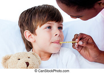 Pensive nurse taking child\'s temperature