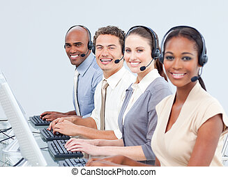 Confident business people working in a call center
